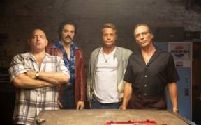 """(L-R) Louis Lombardi as Pauly Callahan, Rhys Coio as Ray Darrow, Travis Fimmel as Harry Barber, and William Fichtner as Enzo Rotella in the Momentum Pictures' action, crime, comedy """"FINDING STEVE MCQUEEN"""". Photo courtesy of Momentum Pictures"""