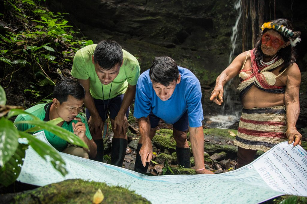 The Waorani communities' maps identify historic battle sites, ancient cave-carvings, jaguar trails, medicinal plants, animal reproductive zones, important fishing holes, creek-crossings, and sacred waterfalls. (Photo credit: Amazon Frontlines)