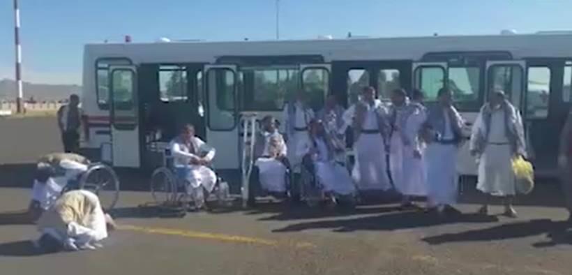 Saudi-held Houthi prisoners of war disembark at Sanaa International Airport in Yemen.