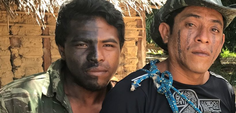 """""""Guardians of the Forest"""" Paulo Paulino Guajajara (left) and Laércio Guajajara (right) pose for a photo before going on patrol in the Araribóia indigenous reserve, in Maranhão state, on Jan 30, 2019. (Photo: Karla Mendes/Mongabay)"""