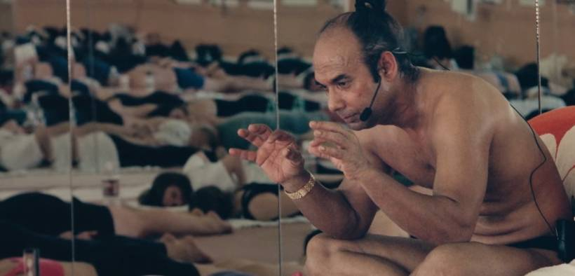 Bikram Choudhury teaching a group yoga class in Bikram: Yogi, Guru, Predator.