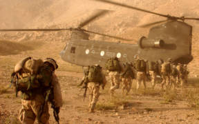 Soldiers quickly march to the ramp of the CH-47 Chinook helicopter that will return them to Kandahar Army Air Field on Sept. 4, 2003. The Soldiers were searching in Daychopan district, Afghanistan, for Taliban fighters and illegal weapons caches. The Soldiers are assigned to Company A, 2nd Battalion, 22nd Infantry Regiment, 10th Mountain Division. (Photo: U.S. Army, Staff Sgt. Kyle Davis)