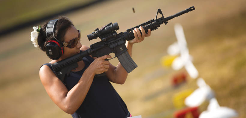 Sarah Richardson, a friend of a Department of Defense employee who works on Marine Corps Base Hawaii, Fires an M4A1 service rifle during the recreational shoot hosted by the Kaneohe Bay Range Training Facility aboard the base. (U.S. Marine Corps Photo By Cpl. Matthew Callahan)