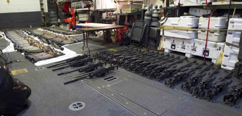 (March 31, 2016) A cache of weapons is assembled on the deck of the guided-missile destroyer USS Gravely (DDG 107). The weapons were seized from a stateless dhow, which was intercepted by the Coastal Patrol ship USS Sirocco (PC 6) on March 28. The illicit cargo included 1,500 AK-47s, 200 RPG launchers, and 21 .50 caliber machine guns. Gravely supported the seizure following the discovery of the weapons by Sirocco's boarding team. This seizure was the third time in recent weeks international naval forces operating in the waters of the Arabian Sea seized a shipment of illicit arms, which the United States assessed, originated in Iran and was likely bound for Houthi insurgents in Yemen. The weapons are now in U.S. custody awaiting final disposition. (Photo by U.S. Navy Photo by Mass Communication Specialist 2nd Class Darby C. Dillon/Released)