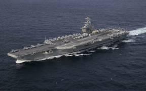 The U.S. Navy aircraft carrier USS Abraham Lincoln (CVN-72) underway in the Atlantic Ocean during a strait transit exercise on 30 January 2019.
