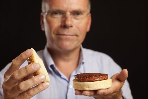 Dr. Mark Post of Mosa Meats holds a 'clean meat' hamburger grown from cell culture. Clean meat is produced without the use of antibiotics and hormones and eradicates animal waste management and thus air and water pollution problems. (Photo credit: The Good Food Institute)