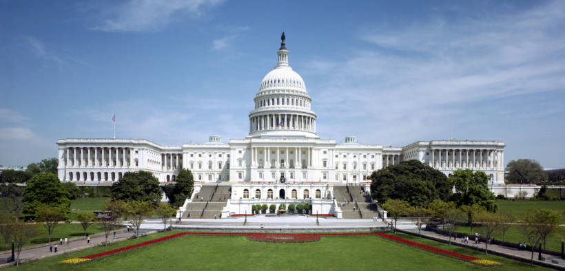 The western front of the United States Capitol. The Neoclassical style building is in Washington, D.C., on Capitol Hill, at the east end of the National Mall.