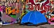 homeless person in tent. Homeless bans now in some states are banning sleeping in public tents.