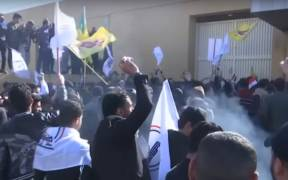 Protesters demonstrate outside the U.S. embassy in Baghdad. (Photo: YouTube)
