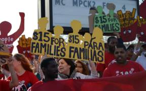 In 2014 fast food workers around the USA walked out on strike. Protesters gathered outside the McDonald's restaurant at Lake Street and 3rd Avenue in Minneapolis. They called for a $15 per hour minimum wage, paid sick days, and union rights.