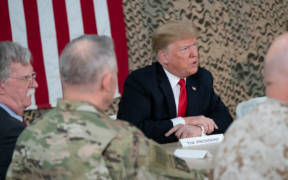 President Donald J. Trump, joined by First Lady Melania Trump, attends a briefing with military leadership members Wednesday, December 26, 2018, at the Al-Asad Airbase in Iraq. (Official White House Photo by Shealah Craighead)