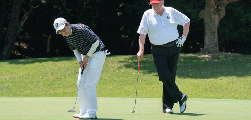 President Donald J. Trump watches as Japan Prime Minister Shinzo Abe makes a putt during their golf game Sunday, May 26, 2019, at the Mobara Country Club in Chiba, Japan. (Official White House Photo by Shealah Craighead)