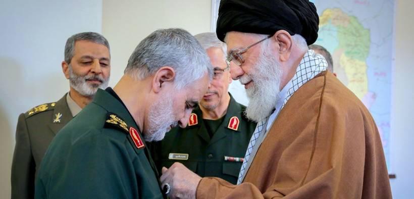 Qasem Soleimani receiving the Zolfaghar Order from Iran's Ayatollah Ali Khamenei.