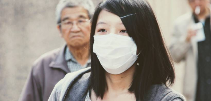 Chinese woman with medical mask on