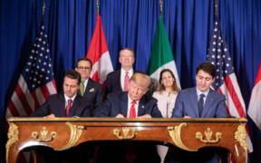 November 30, 2018 President Donald Trump and Mexican President Enrique Peña Nieto and Canadian Prime Minister Justin Trudeau in Buenos Aires, Argentina (Buenos Aires) signs agreement. (Official White House Photo by Shealah Craighead)