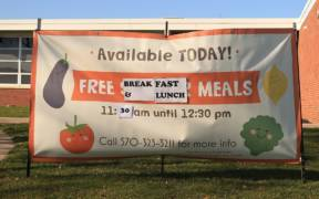 1024px COVID 19 Free Meals Sign for Children and Students