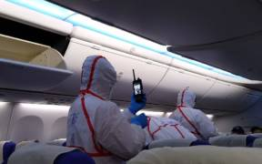 996px Quarantine staff screening passengers in Shenzhen