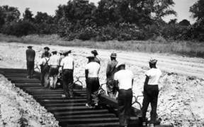 African American workers laying railroad ties for spur line 1942 27255092036 e1592543128379