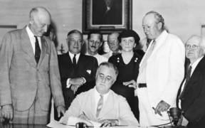 Signing Of The Social Security Act e1597418910864