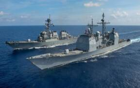 USS Bunker Hill CG 52 and USS Barry DDG 52 underway in the the South China Sea on 18 April 2020 200418 N IW125 2047